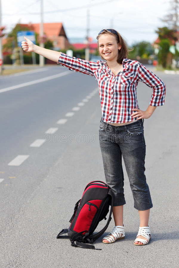 Download Teen girl hitch hiking stock image. Image of woman, hike - 33350367