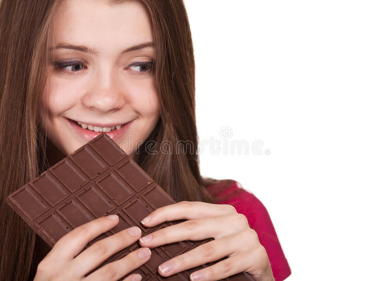 Teen girl holding big chocolate bar