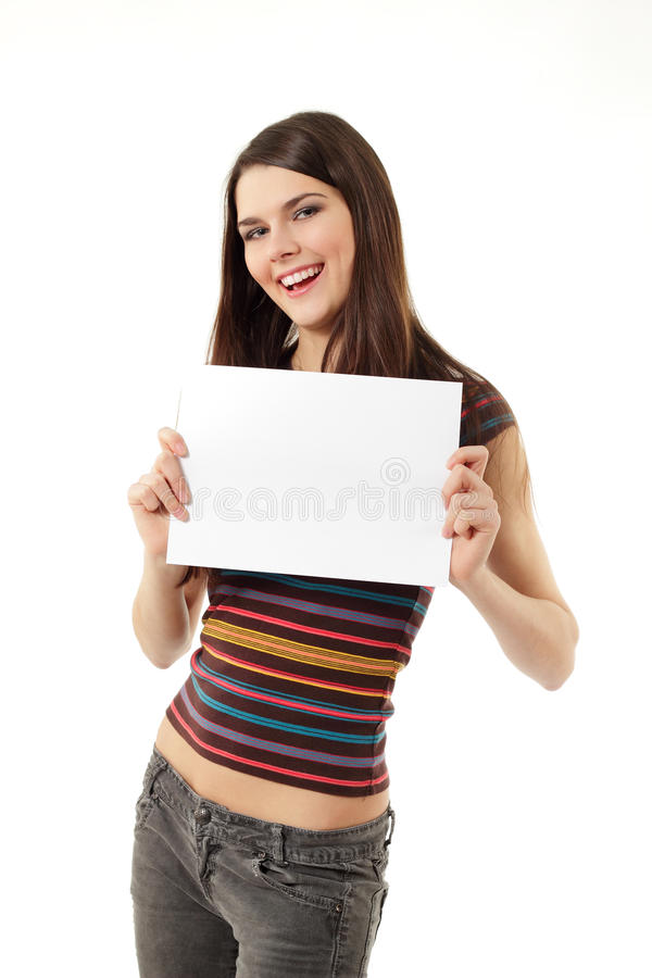 Teen girl holding blank white paper royalty free stock images