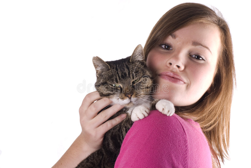 Teen girl holding cat. Pretty teenage girl holding her cat, isolated on a white background stock photos
