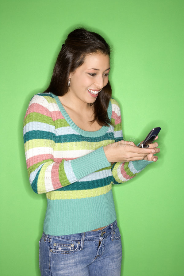 Teen girl holding cell phone. stock photo