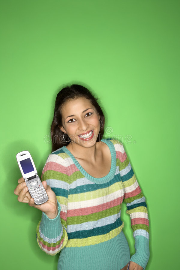 Teen girl holding cellphone. stock photography