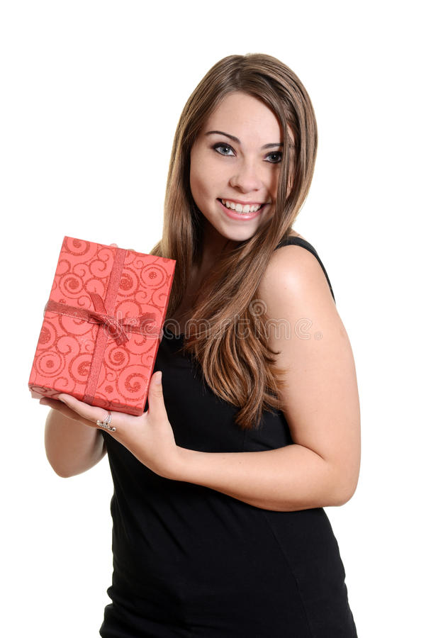 Teen girl holding christmas present