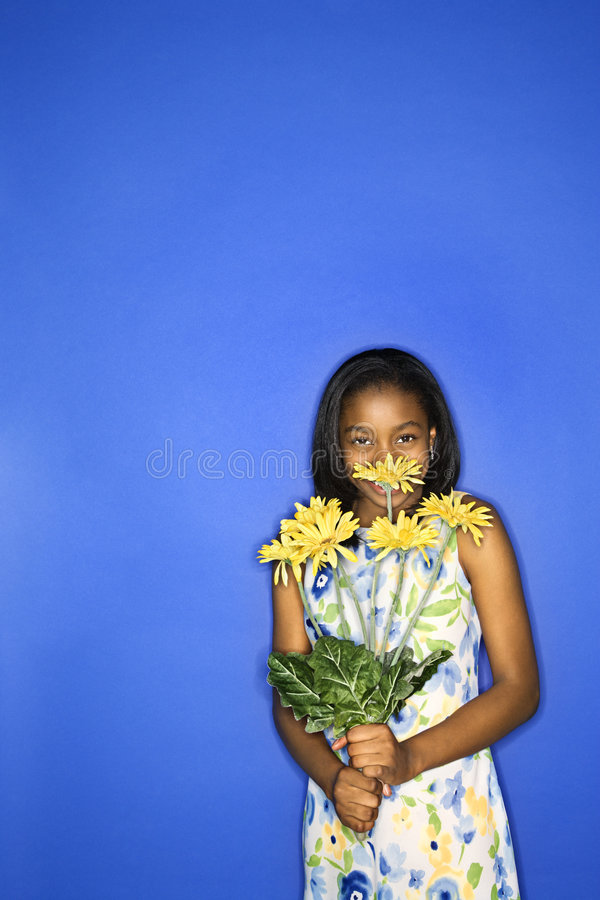 Teen girl holding flowers. royalty free stock photography