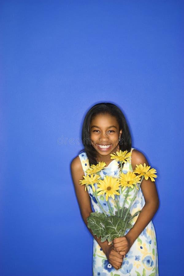 Teen girl holding flowers. royalty free stock photos