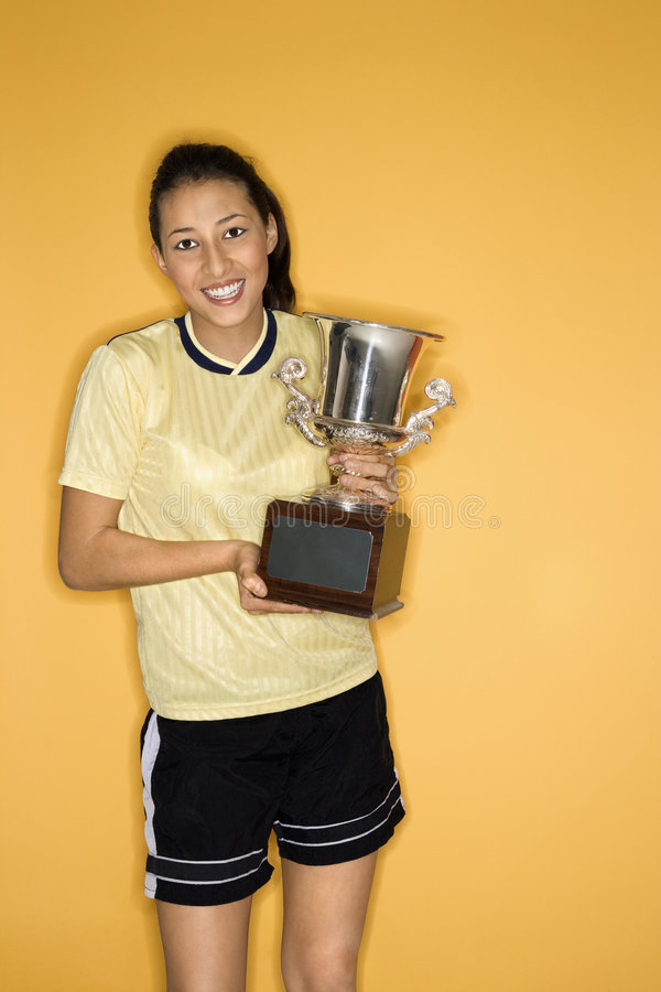 Teen girl holding trophy. royalty free stock photography