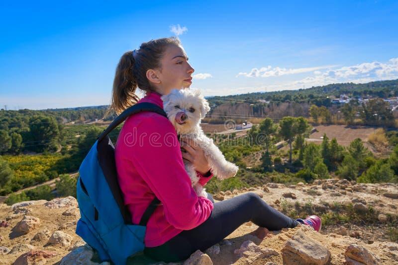 Teen girl hug maltichon in outdoor royalty free stock photography