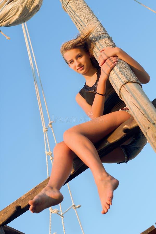 Teen Girl Hugging The Mast Stock Image