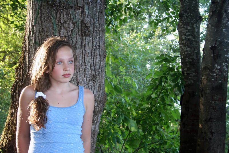 Download Teen Girl Leaning Against Tree Stock Image - Image: 10065933