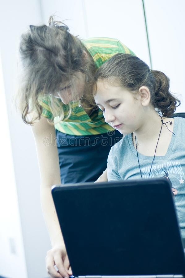 Teen girl learning computers royalty free stock images