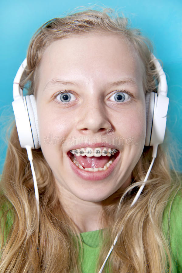 Teen girl listening to music royalty free stock photo