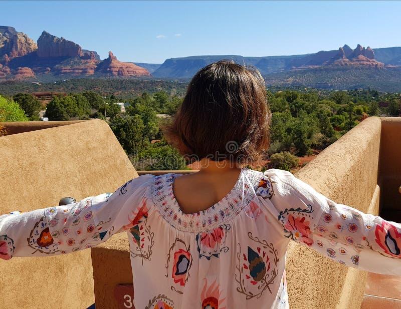 Teen girl looking over Sedona stock image