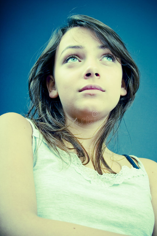 Teen girl looking up royalty free stock images