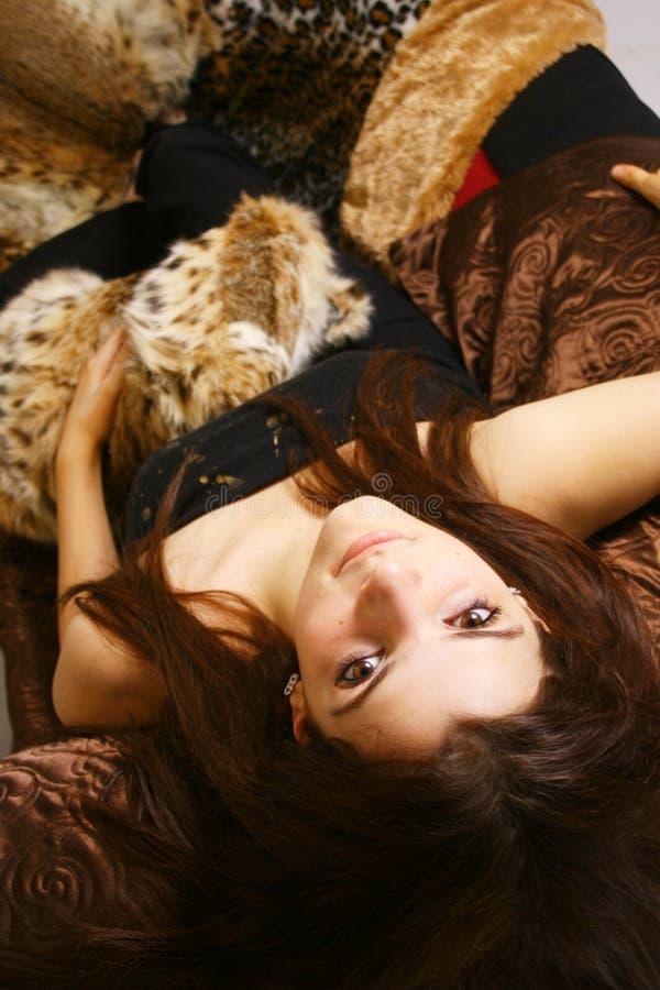 Teen girl lying on back stock images