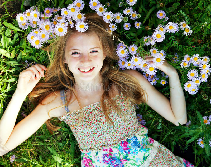 Teen girl lying in grass stock images