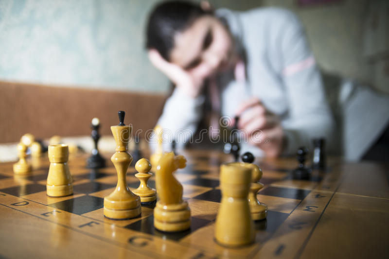 Teen girl making checkmate playing chess. She is winner stock photos