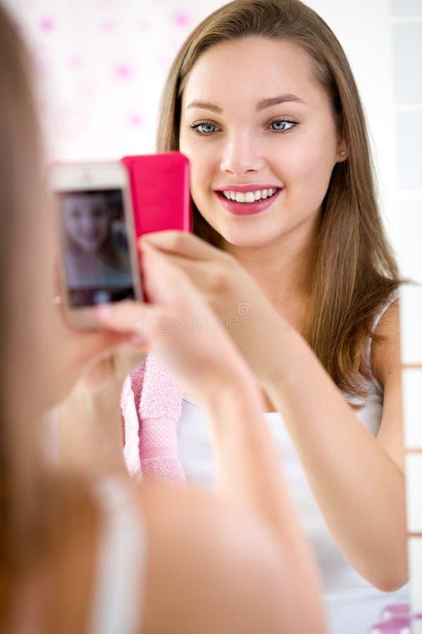 Teen girl making self-portrait royalty free stock photo