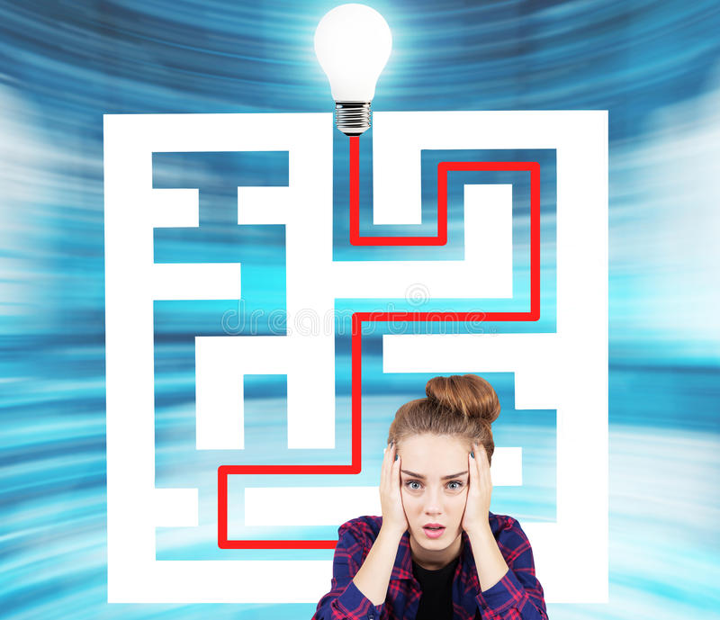 Teen girl and a maze with a light bulb stock image