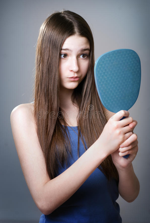 Teen girl with a mirror stock photos