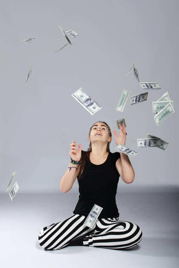 Teen girl and money stock photo