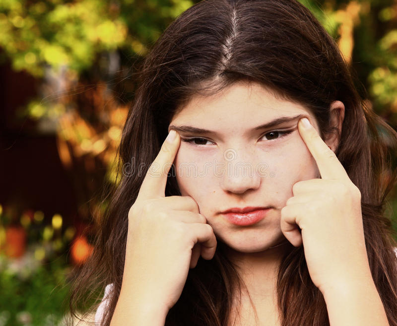 Teen girl with myopia try to see something far away royalty free stock photos