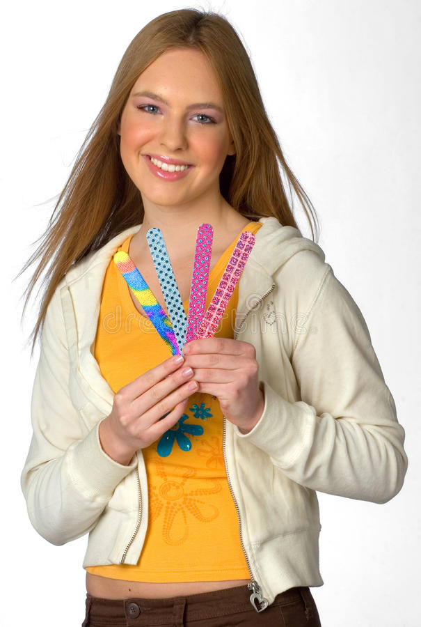 Download Teen girl with nail files stock image. Image of white - 13528305