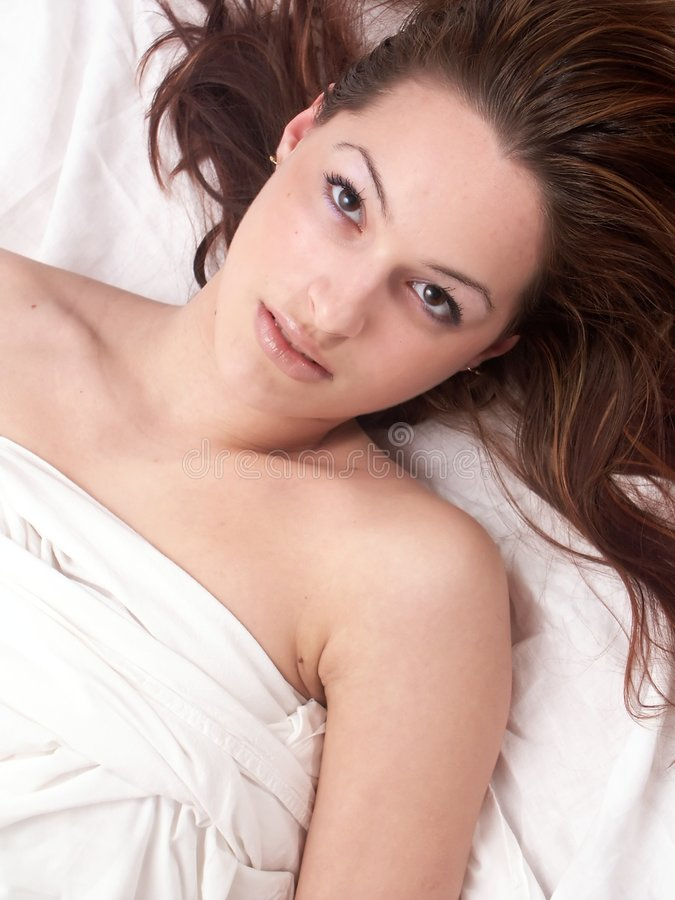 Teen girl naked in bed royalty free stock images