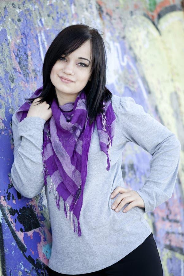 Free Teen Girl Near Graffiti Wall Stock Photography - 24522492