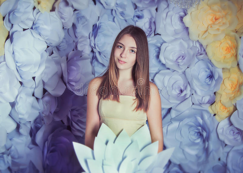 Teen girl with paper flower royalty free stock image