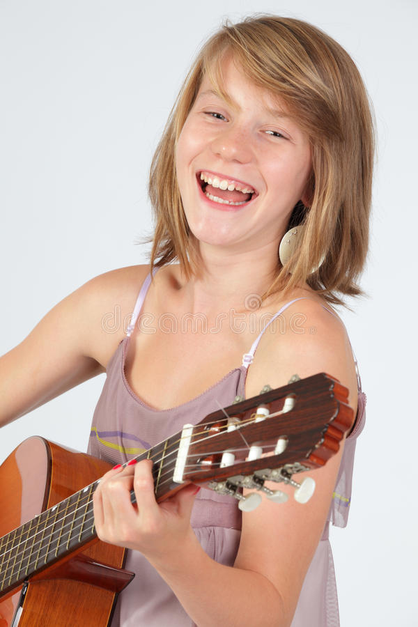 Teen girl playing guitar stock photos