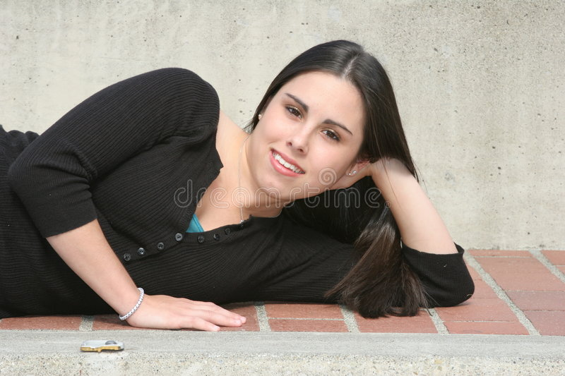 Teen Girl Portrait. A very pretty teenage girl modeling for a photo shoot stock image