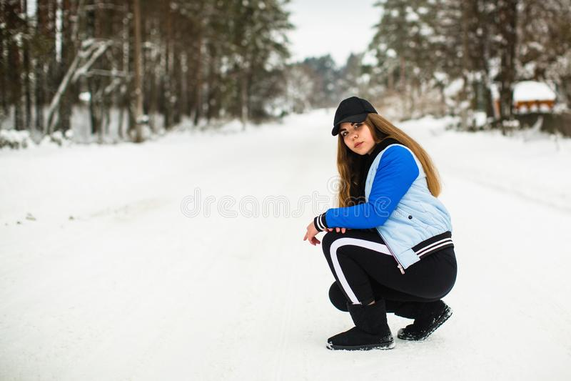 Teen girl portrait of gop-style in the park in snowy winter. Nature. Teen girl portrait of gop-style in the park in snowy winter royalty free stock images