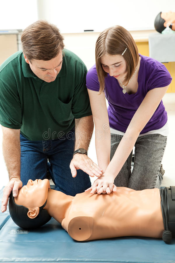 Free Teen Girl Practices CPR Royalty Free Stock Photos - 20228308