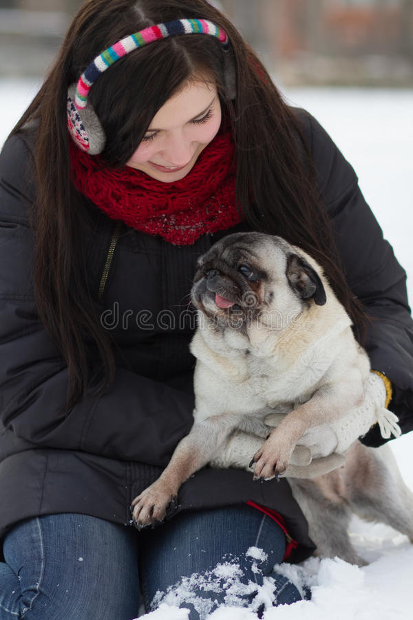Download Teen Girl With Pug Puppy In Snow Stock Image - Image: 28626997