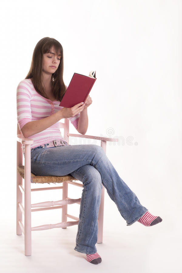 Download Teen Girl Reading Book In Chair Stock Photo - Image of hard, chair: 25121458