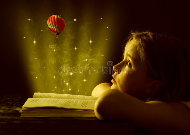 Teen girl reading the Book. Education stock photography