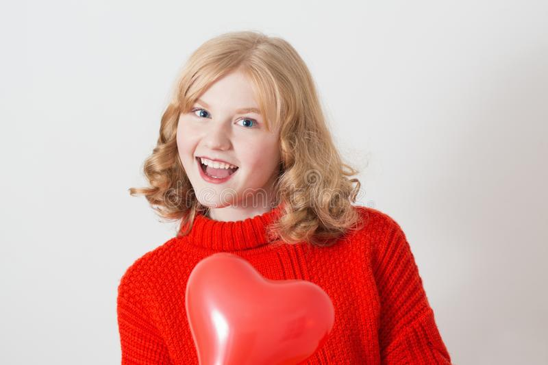 Teen girl with red balloons on white background royalty free stock photos
