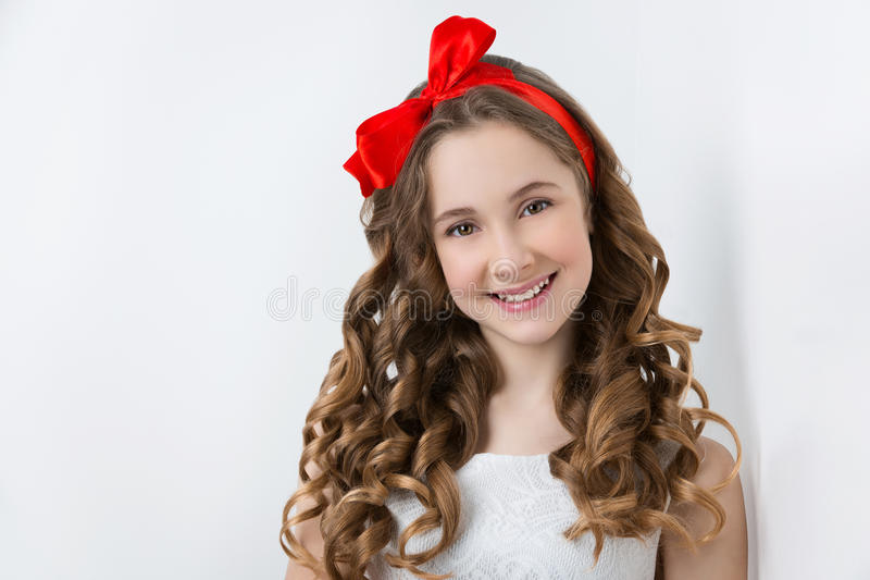 Teen girl with red bow on head royalty free stock photography