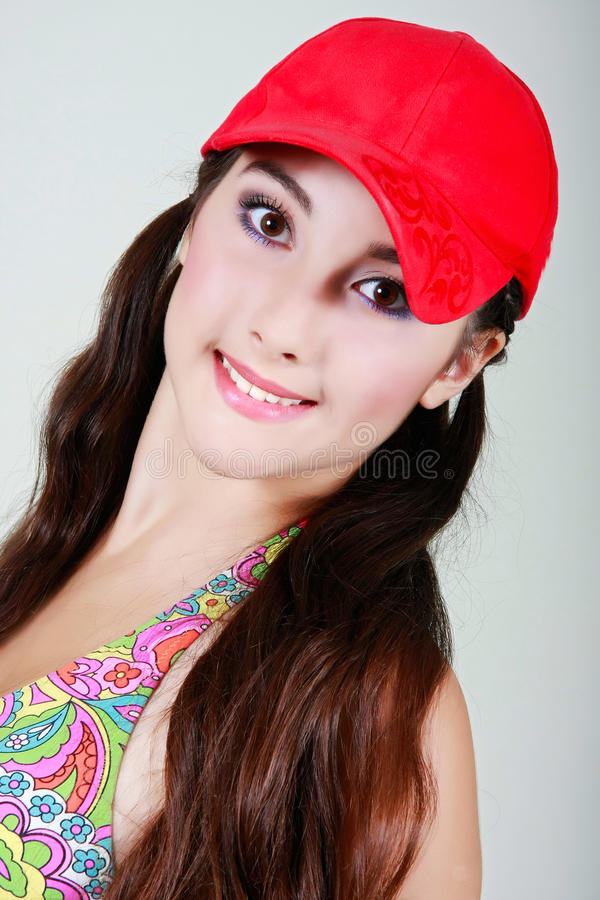 Download Teen girl in red cap stock photo. Image of adult, clean - 10320346