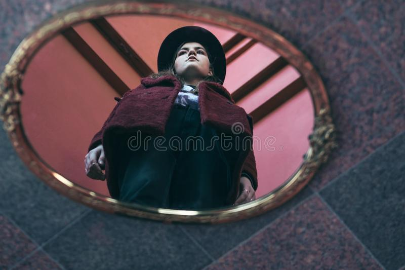 Teen girl reflection on the mirror. diversity of opinions. Creative portrait. Red colors. Teen girl reflection on the mirror. diversity of opinions. Creative royalty free stock images