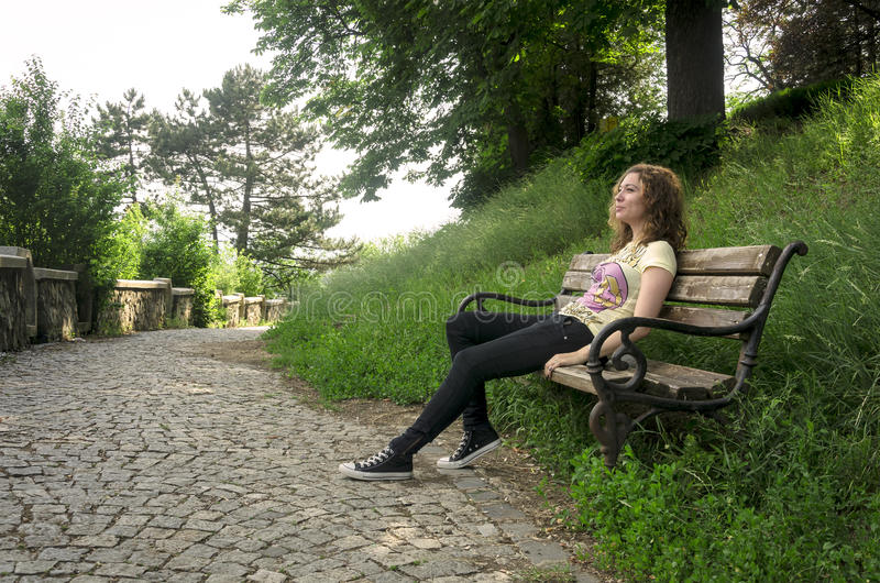 Download Teen Girl Relaxing On A Bench Stock Photo - Image: 25259812