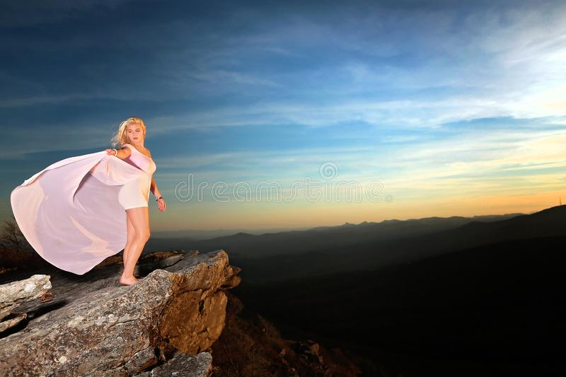 Teen girl on a rock overlook in the mountains stock photos
