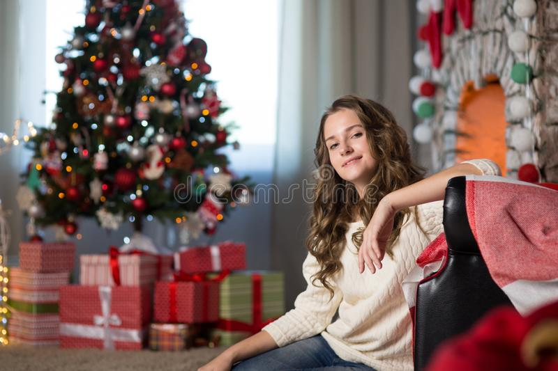 Teen girl in a room for Christmas stock photography