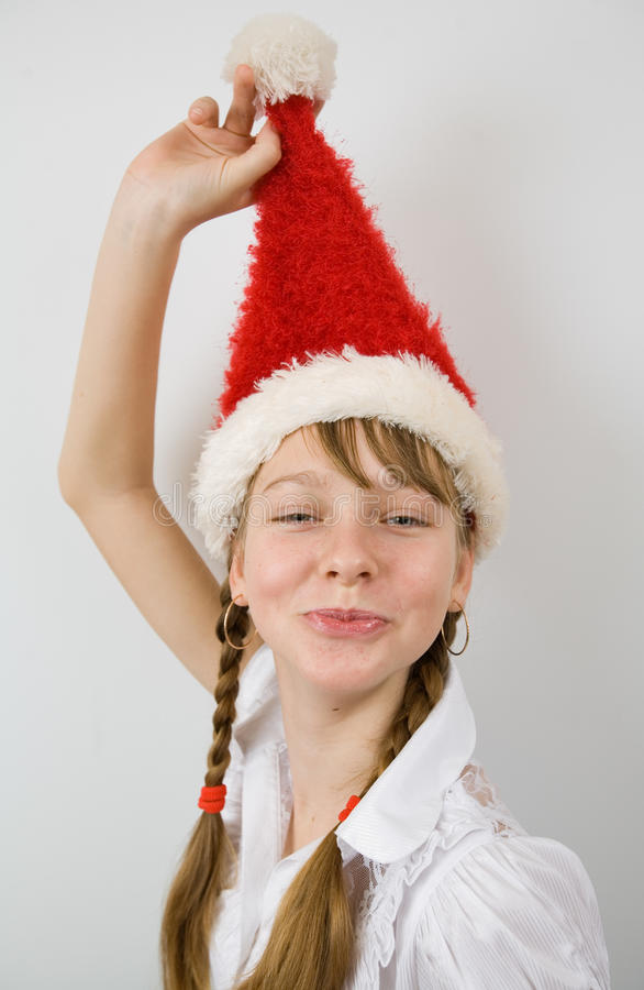 Download Teen girl in Santa hat stock image. Image of child, looking - 23025595