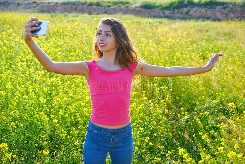 Teen girl selfie video photo spring meadow. Teen girl selfie video photo in spring meadow royalty free stock photography