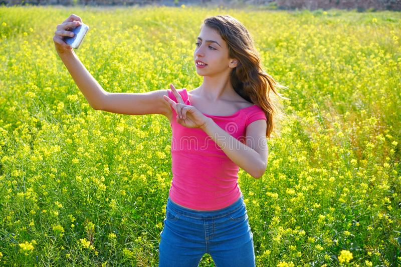 Teen girl selfie video photo spring meadow. Teen girl serfie video photo in spring meadow gesturing royalty free stock images