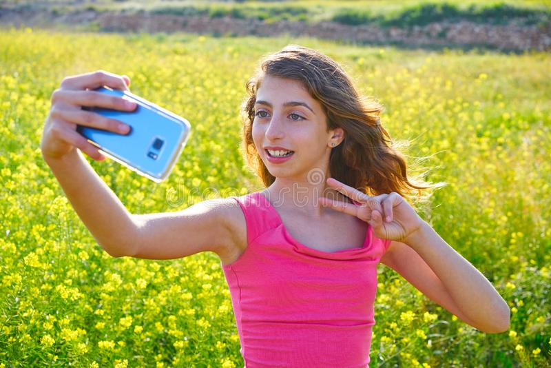 Teen girl selfie video photo spring meadow. Teen girl serfie video photo in spring meadow gesturing stock photography