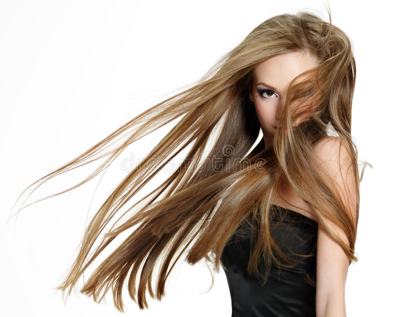 Teen girl shaking head with long hair stock photos