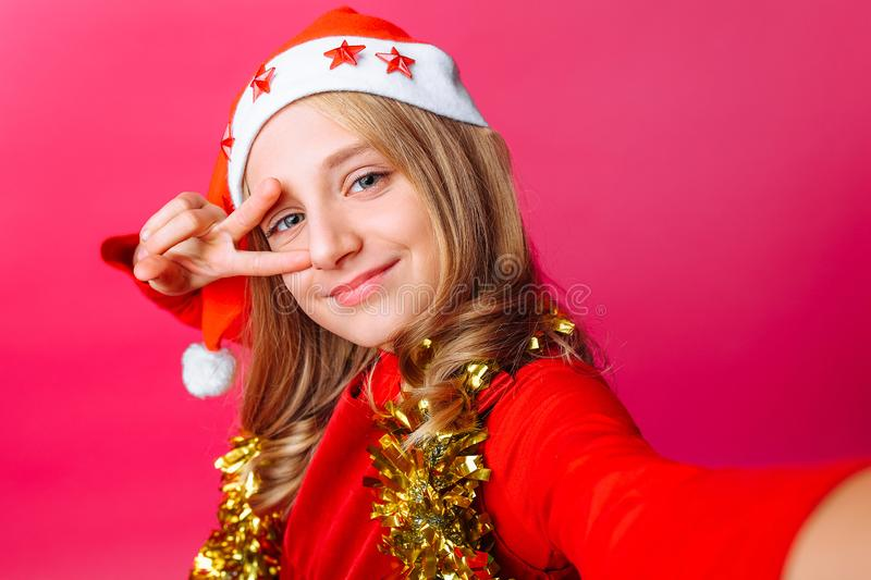 The teen girl shows a greeting gesture and takes a selfie in San stock images