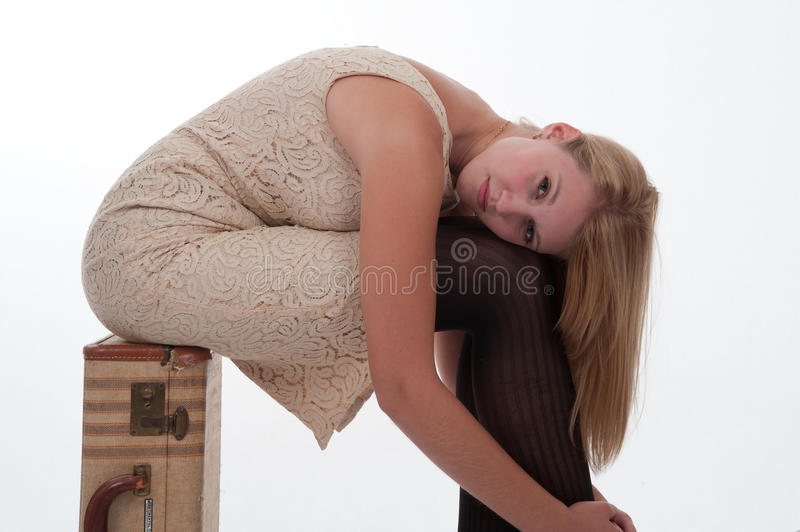 Download Teen Girl Sitting On A Suitcase Stock Photo - Image of alluring, blonde: 12626914